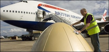 Simon Palmer polishing the British Airways golden aeroplane nose cone