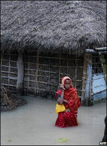 Woman standing outside her house