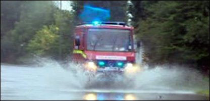 Fire engine trying to get through the floods