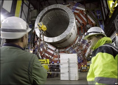 the giant magnet Compact Muon Solenoid (CMS) being placed underground in the Large Hadron Collider (LHC)