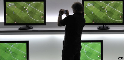 Football being shown on TV screens