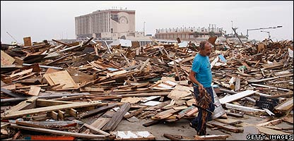 Man searches amongst the debris following the storm