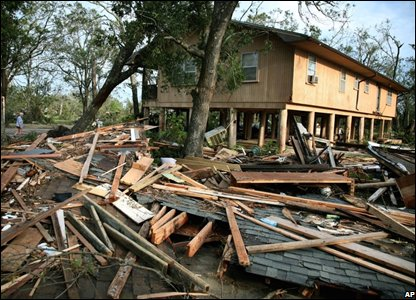 Part of a home is destroyed, in Oak Island, Texas (AP Photo/Dallas Morning News, Guy Reynolds)