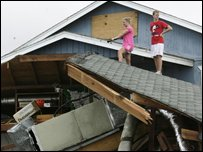 People looking at damaged home in Surfside Beach, Texas (AP Photo/Houston Chronicle, Julio Cortez)