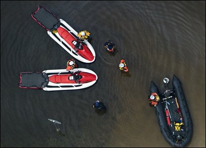 Rescue boats are seen in the flood waters of Hurricane Ike September 14, 2008 in Bridge City, Texas  (Photo by Smiley N. Pool-Pool/Getty Images)