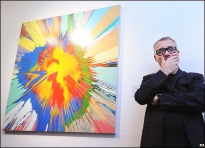 Damien Hirst with his painting Beautiful Atomic Collision of Flames: Force of Nature Painting