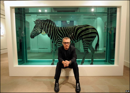 Damien Hirst in front of one of his artworks, The Incredible Journey
