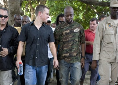 Actor Matt Damon, second left, walks with Haitian-born singer Wyclef Jean (AP Photo/Ariana Cubillos)