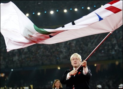 Boris Johnson with the International Paralympic flag (Photo: STR/AFP/Getty Images