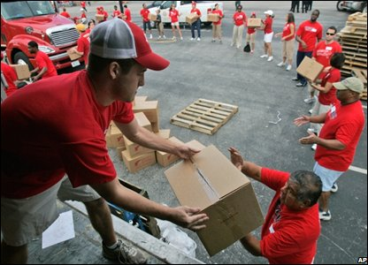 Volunteers handing out food boxes  (AP Photo/Marcio Jose Sanchez)