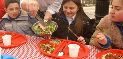 A girl eating a school dinner