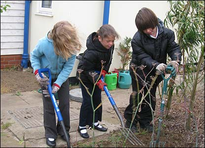 Children gardening at a school