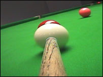 Snooker table from a the point of view of the cue