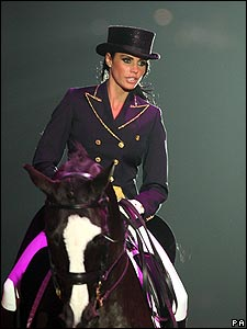 Katie rode into the ring on her horse as her husband Peter Andre's hit song Mysterious Girl played.