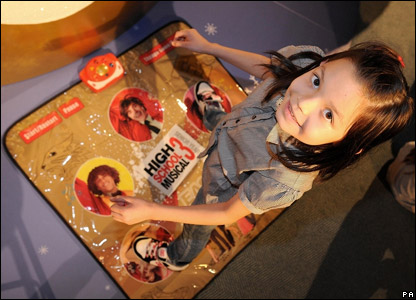 A girl trying out the High School Musical dance mat
