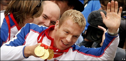 Triple gold medallist Chris Hoy during a victory parade in Scotland