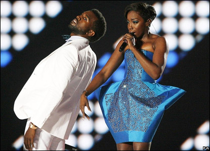 Kanye West performing with Estelle