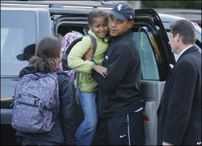 President-elect Obama, center, takes his daughter Malia, and Sasha, to school