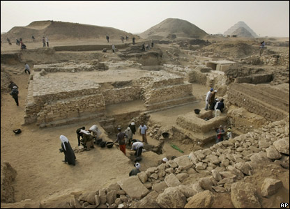 Archaeology workers digging at the site of a newly-discovered pyramid in Egypt