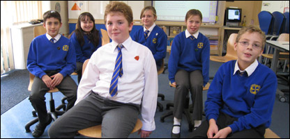 Pupils try out the new chairs