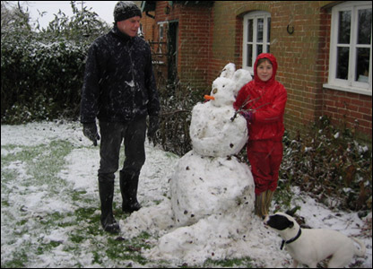 Zilah with her dad and dog and the snow bunny they made