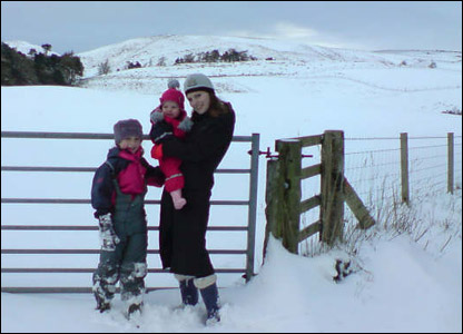 Emily poses with her sister and niece in the snow in Aberdeenshire