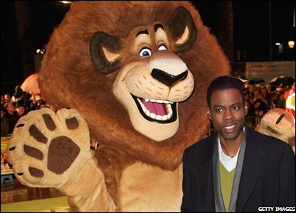 Comedian Chris Rock with Alex the Lion