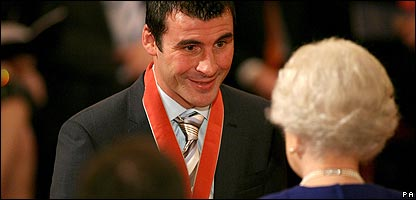 Joe Calzaghe gets his CBE from the Queen