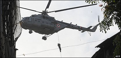 An Indian soldier uses a helicopter to help hostages