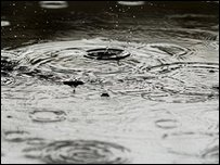 Raindrops falling into a puddle (SHAUN CURRY/AFP/Getty Images)