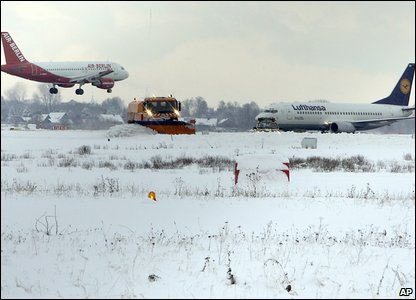 Planes landing near snow covered field  (AP Photo/Frank Augstein)