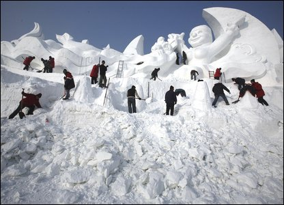 A snow sculpture takes shape at the Snow Festival in Harbin, northeastern China's Heilongjiang province  (AP Photo/Ng Han Guan)