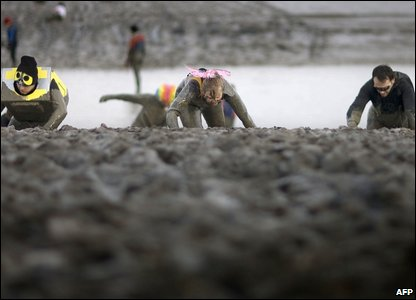 Competitors take part in the Maldon Mud Race in Maldon (Photo by BEN STANSALL/AFP/Getty Images)