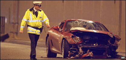 A policeman next to Ronaldo's smashed car