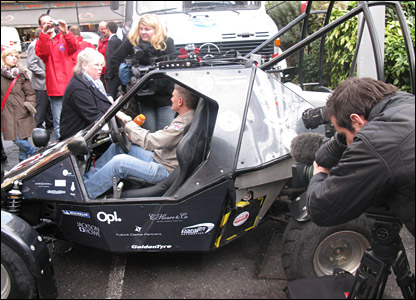 Pilot Neil Laughton with the flying car, surrounded by press