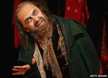 Rowan Atkinson performing as Fagin in Oliver