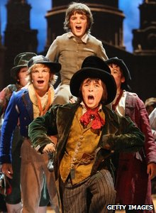 Some of the castperforming in Oliver