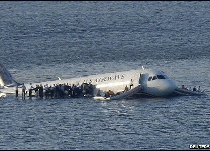 Passengers standing on the wing of the plane in the Hudson River