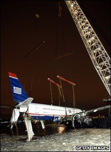Plane being lifted out (photo by Edouard H.R.Gluck-Pool/Getty Images)