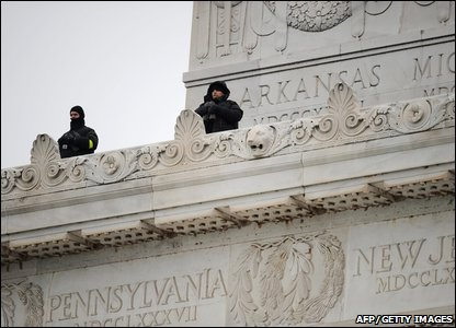Security experts watch the crowd from the top of the Lincoln memorial