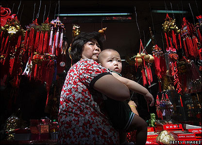Chinese New Year is celebrated all over the world - here in Manila in the Philippines, a stall is selling gifts.