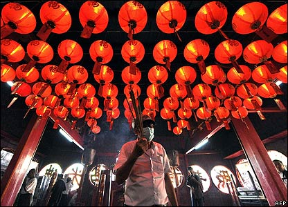 And here, a man walks under lanterns during Chinese Lunar New Year prayers in Indonesia, south-east Asia.