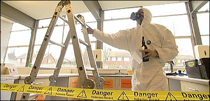 Someone clearing asbestos from a school