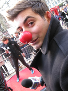 Ricky tries out a red nose for size