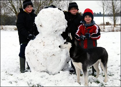 Cameron with his brothers Seth and Archie and their giant snowman