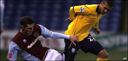 Burnley's Chris McCann, left, tackles West Bromwich Albion's Gianni Zuiverloon
