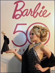 Someone posing for Barbie's 50th birthday