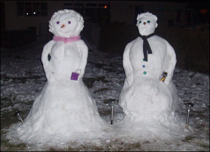 A snowman and snow-woman in Neath, south Wales