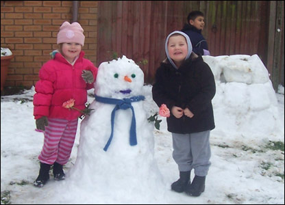 Ella and Cameron with their snowman