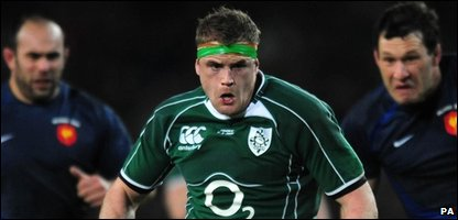 "Ireland""s Jamie Heaslip runs through to score a try"